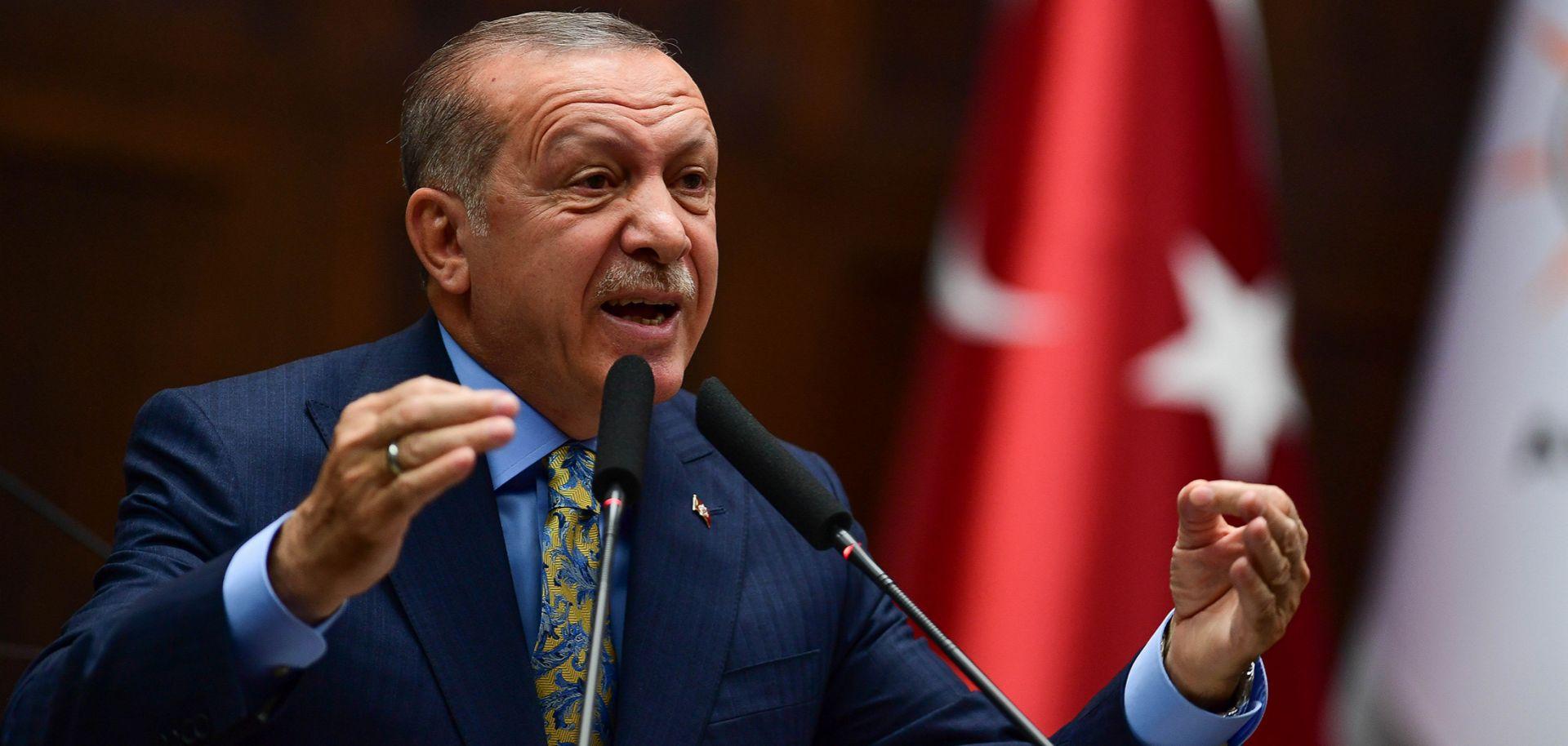 President Recep Tayyip Erdogan speaks about the slaying of Saudi journalist Jamal Khashoggi during a weekly parliamentary address on Oct. 23 in Ankara.
