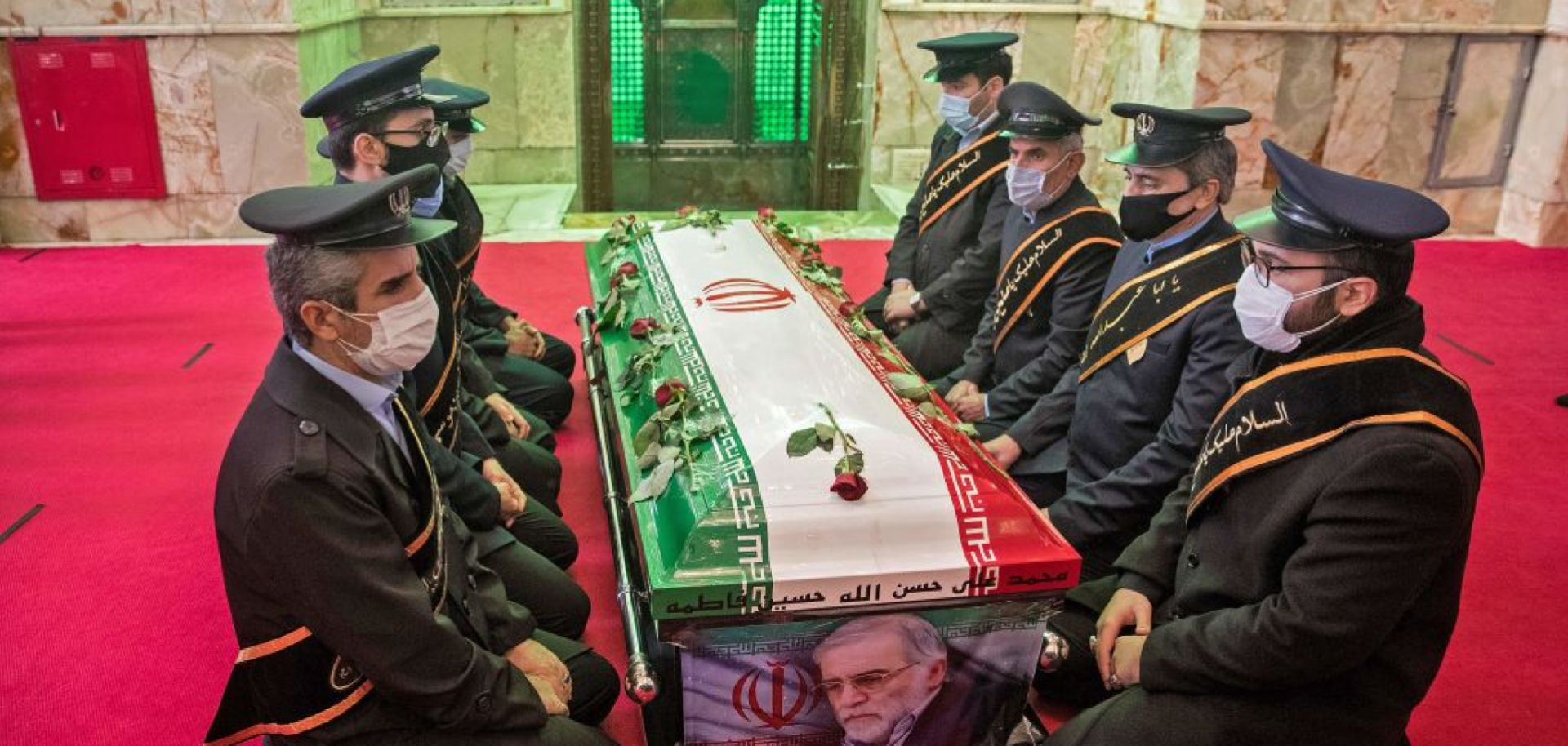 Members of Iranian forces pray around the coffin of slain nuclear scientist Mohsen Fakhrizadeh during his burial ceremony at Imamzadeh Saleh shrine in northern Tehran on Nov. 30, 2020.