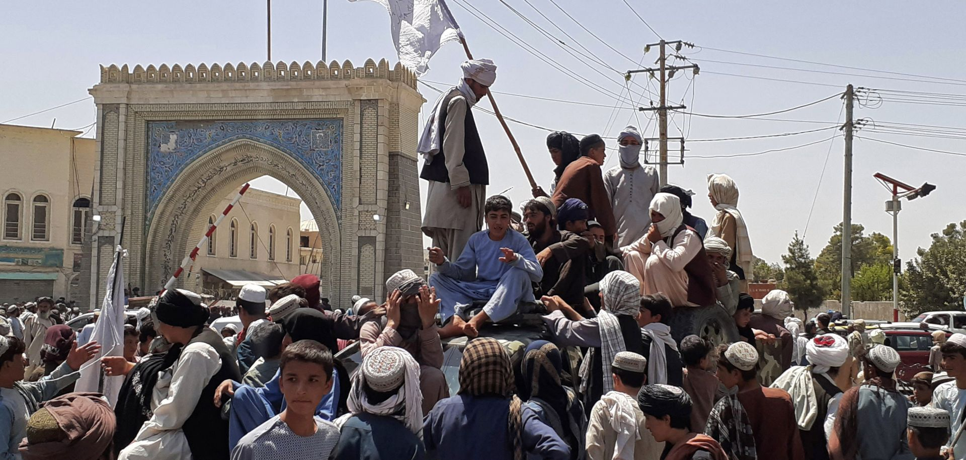 Taliban fighters stand on a vehicle in Kandahar, Afghanistan, on Aug. 13, 2021.