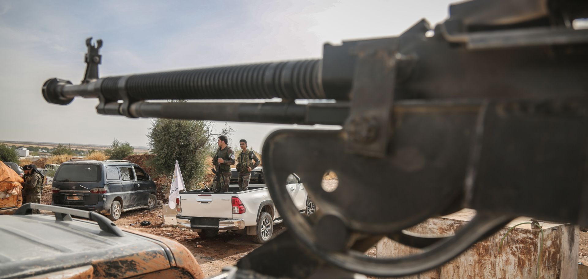 This photo shows fighters with the Turkish-backed Syrian National Army gathered near the Turkish border in northeastern Syria on Oct. 11, 2019.