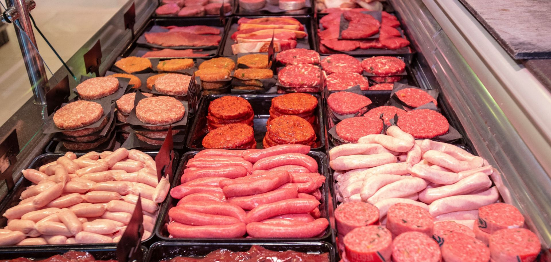 Pork sausages and beef burger patties are seen at a butcher's shop in Ballymena, Northern Ireland, on Dec. 10, 2020.
