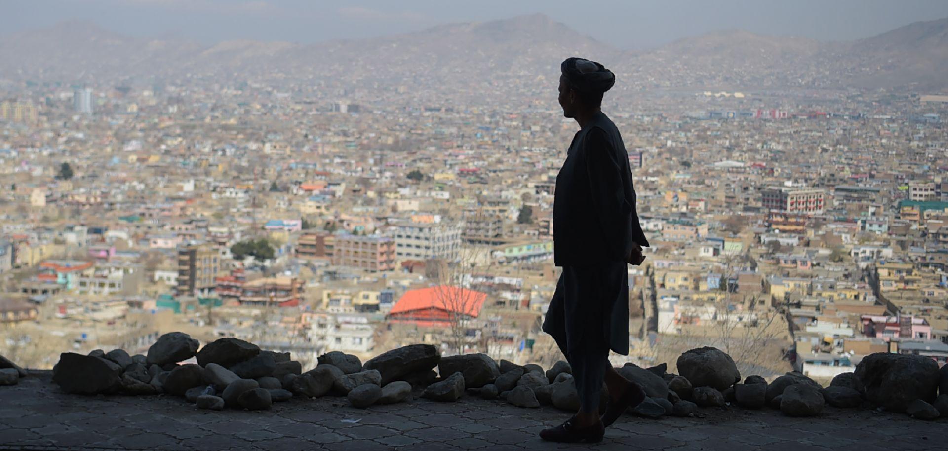 An Afghan man walks along a hilltop overlooking Kabul on March 21, 2018.