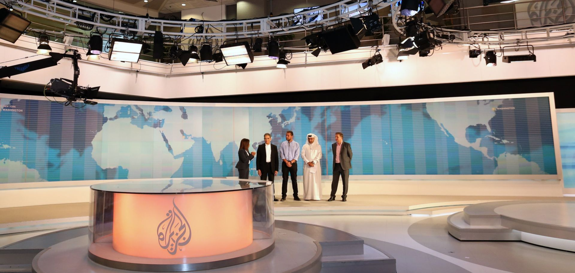 """Officials from Al Jazeera English welcome journalist Baher Mohamed back to the network after his release from prison in Egypt, where he was convicted of disseminating """"false news."""""""