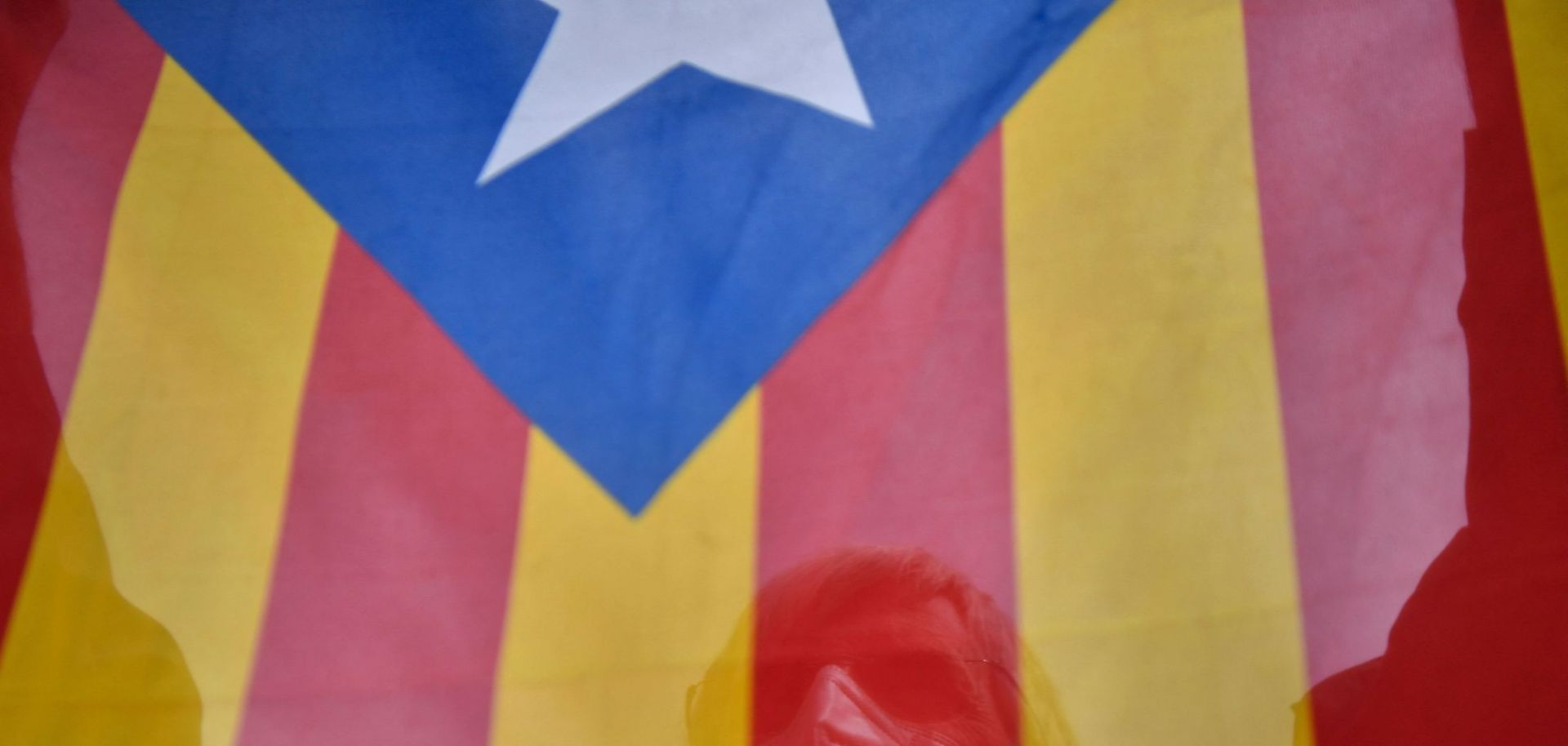 A man holds up a Catalan pro-independence Estelada flag during a demonstration in Barcelona on May 16, 2021.