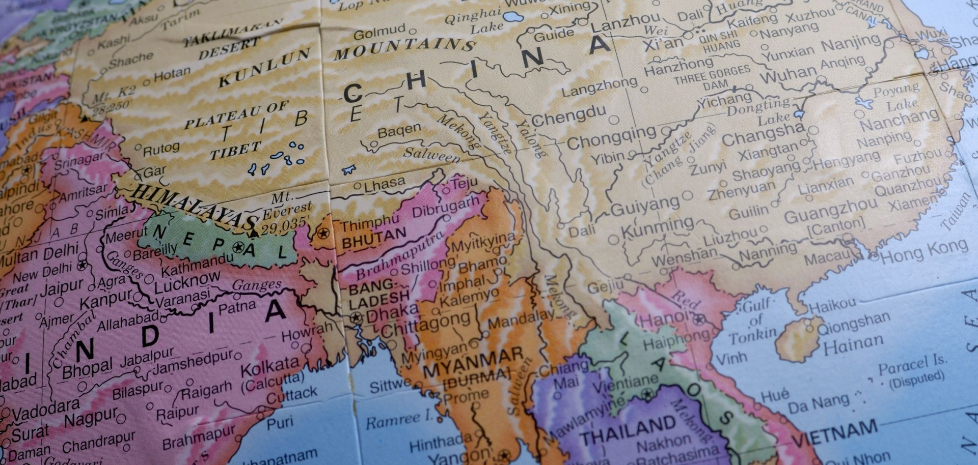 In this photo, a map shows the positions of China and India on the globe.