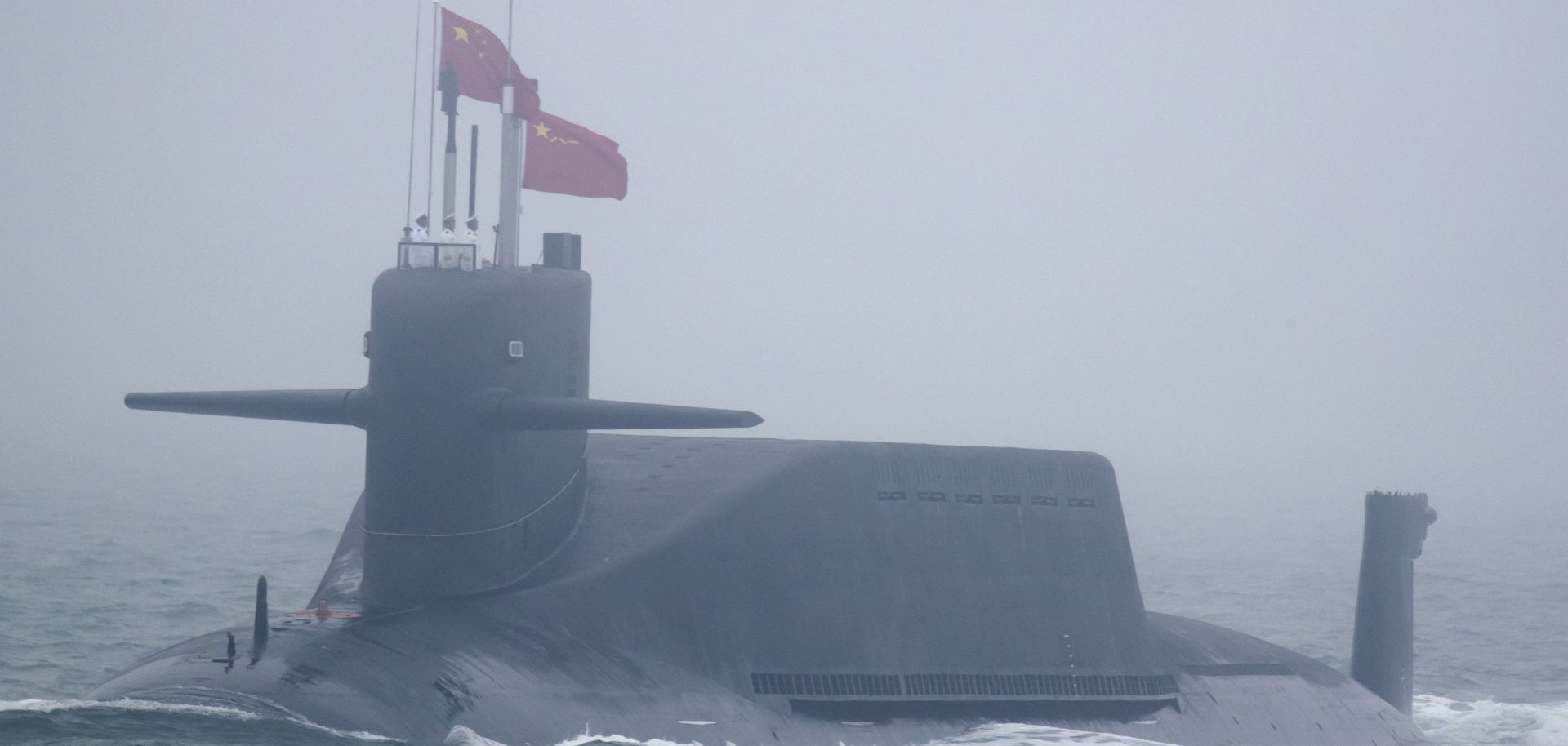 A new type 094A Jin-class nuclear submarine of the Chinese People's Liberation Army Navy participates in a naval parade to commemorate the 70th anniversary of the founding of China's PLA Navy in the sea near Qingdao, in eastern China's Shandong province on April 23.