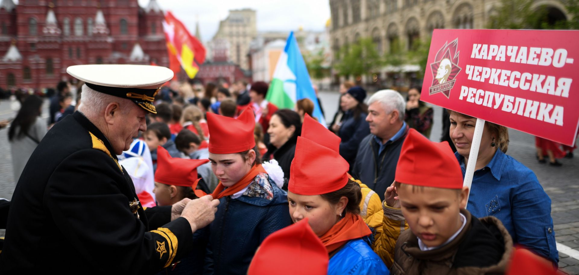Russian children are initiated into the Communist Party's Young Pioneer group. The Party's efforts to rebrand itself include attracting more young Russians to join its youth organizations.