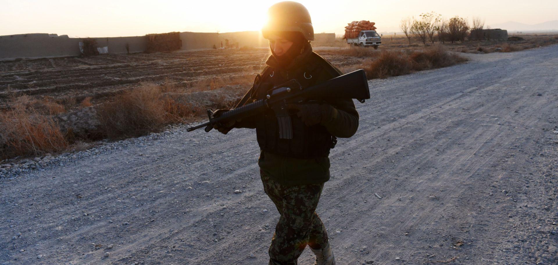 An Afghan soldier on patrol in southern Afghanistan, Dec. 11, 2014.
