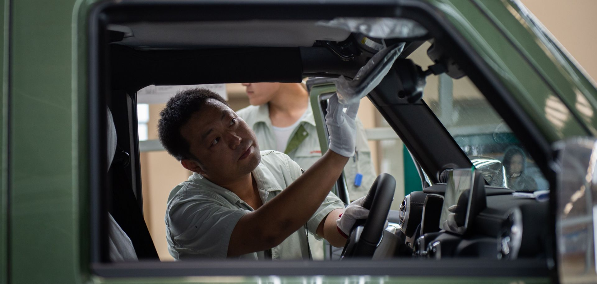 A Chinese autoworker is pictured on an SUV production line for the BAIC Motor Corp. on Aug. 29, 2018.