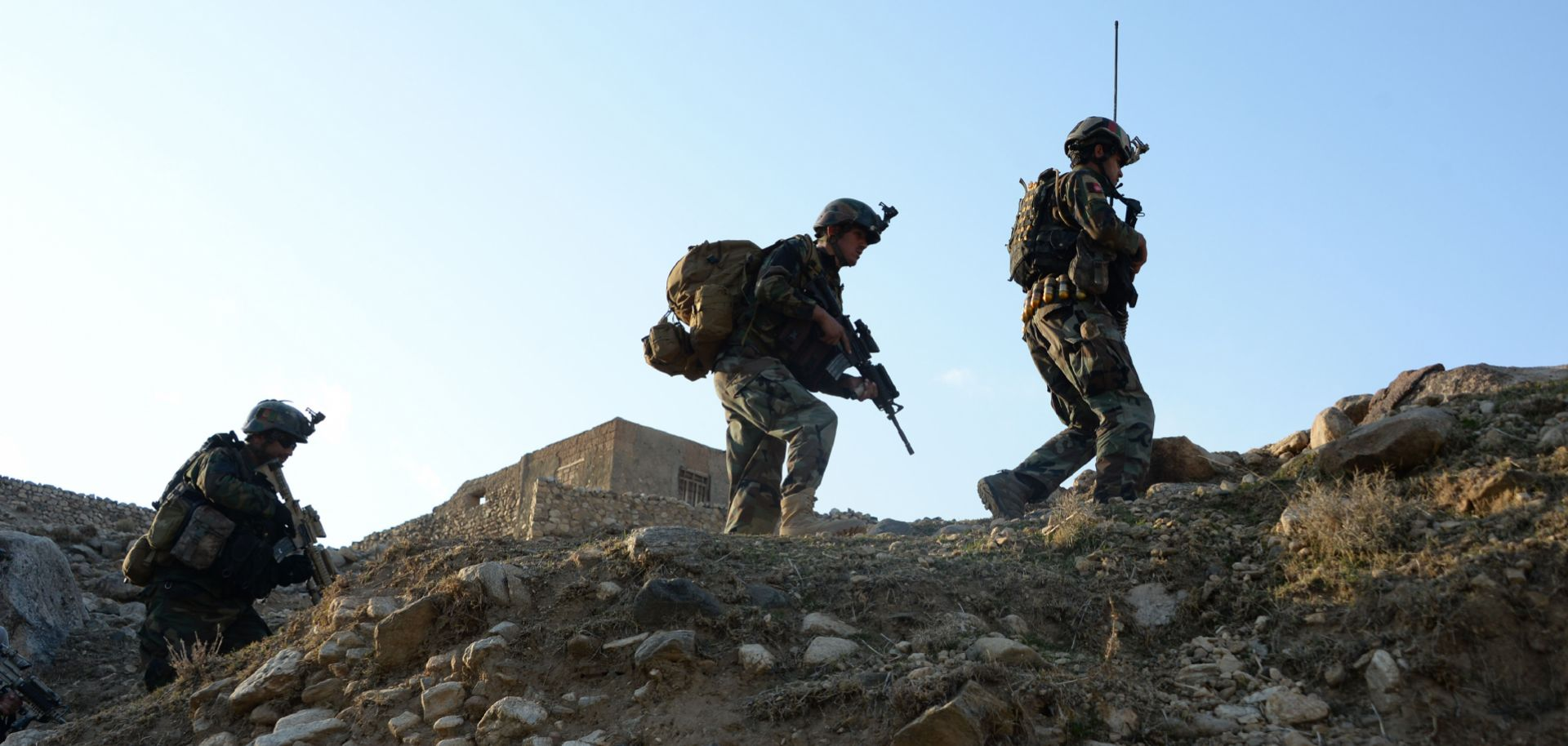 Afghan commandos patrol the Achin district of Nangarhar province during a U.S.-Afghan military operation against Islamic State militants on Jan. 3, 2018.