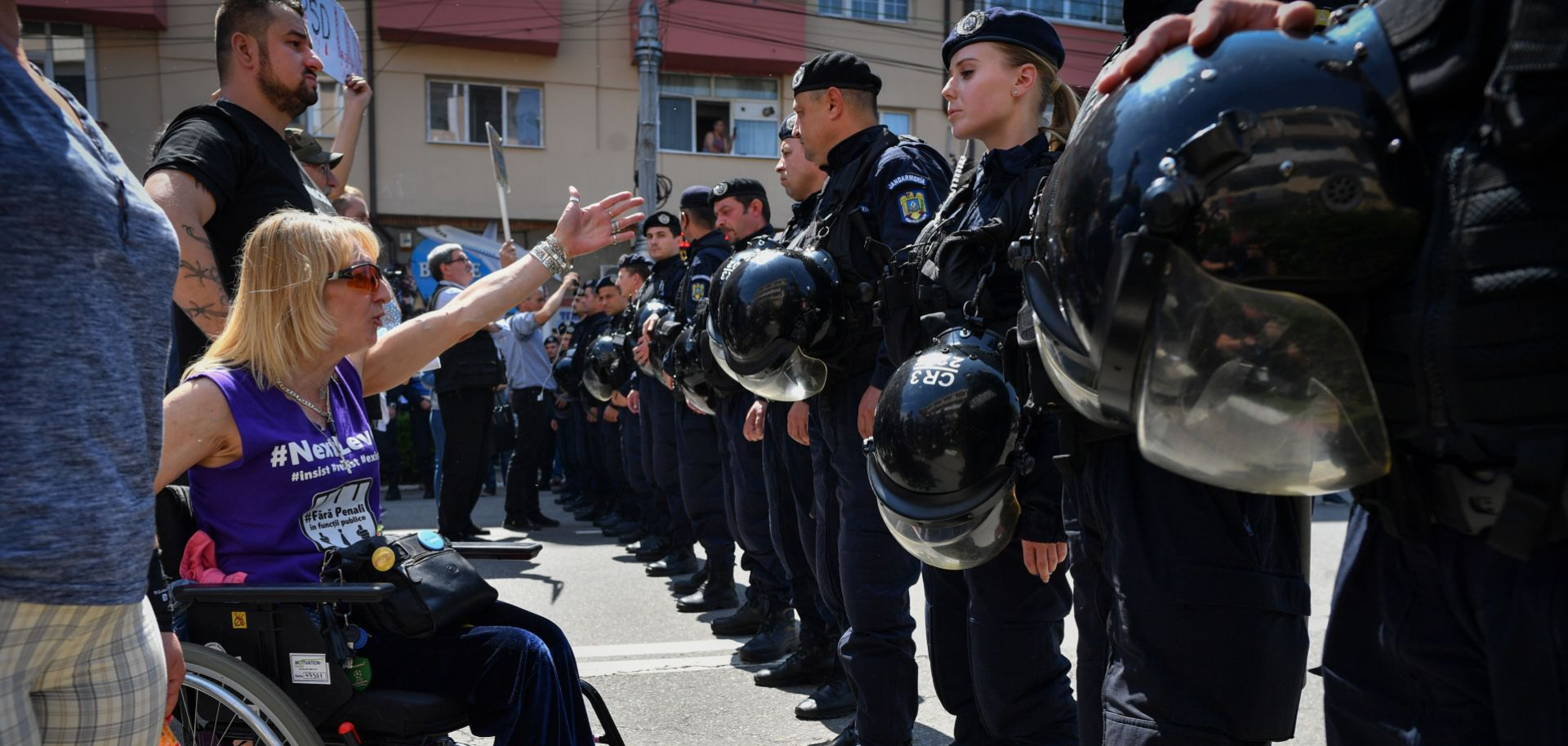 An anti-government protester shouts at supporters of Romania's Social Democratic Party (PSD) coming to attend an EU elections rally in Targoviste on May 19, 2019.