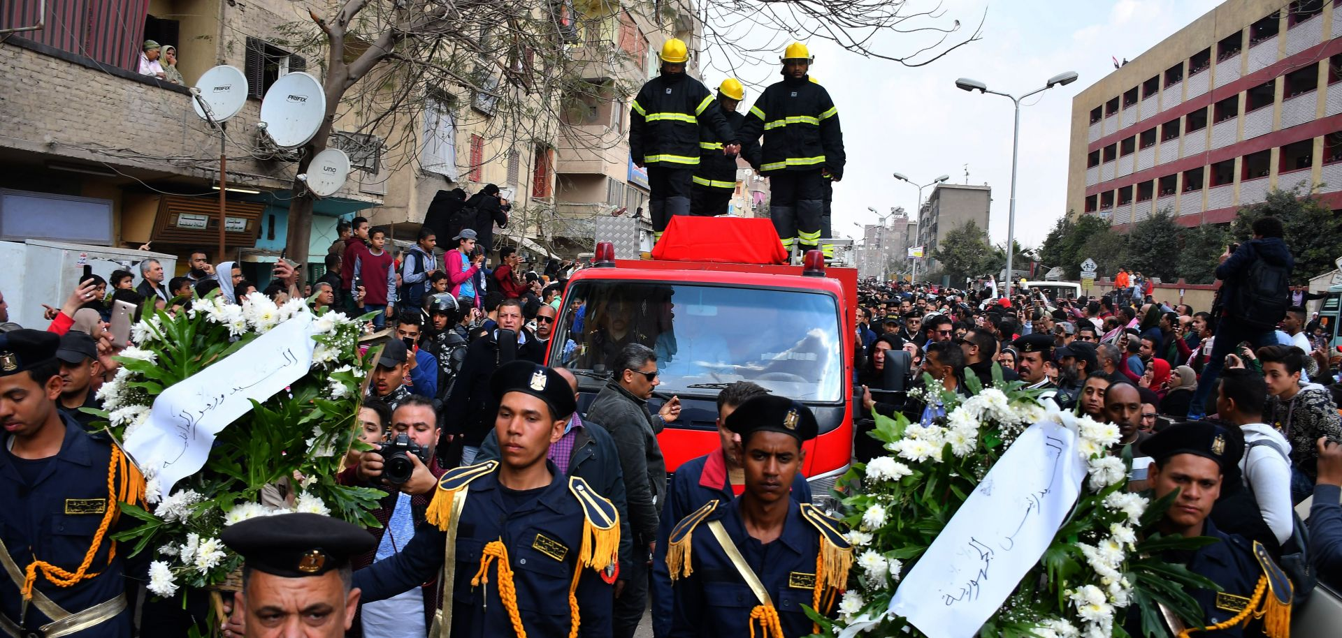 Policemen carry wreaths in Cairo on Feb. 19, 2019, at the funeral of Mahmud Abu el-Yzied, one of three policemen killed in a bombing the previous day.