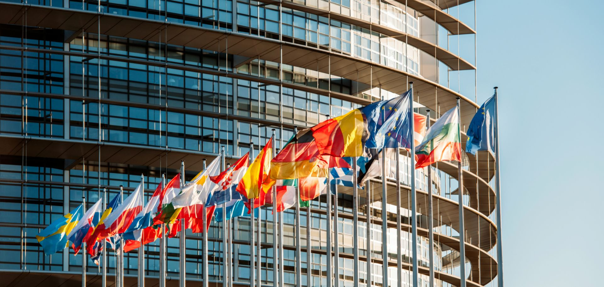 Flags wave in front of the European Parliament building in Strasbourg, France.