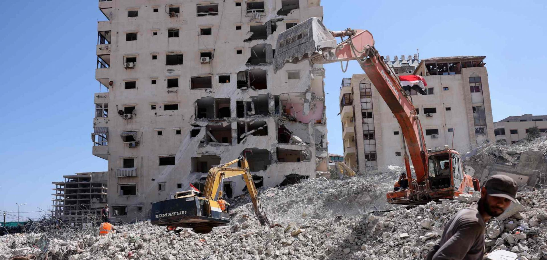Excavators provided by Egypt help clear the rubble in Gaza on June 23, 2021, following last month's flare-up between Israel and the Palestinian militants.