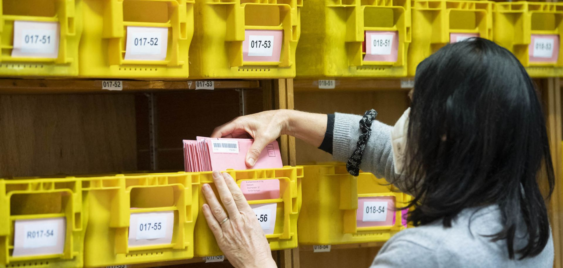 A staff member of the statistic office sorts postal voting envelopes by the numbers of the electoral districts on March 2, 2021, in Stuttgart, Baden-Wuerttemberg, Germany.