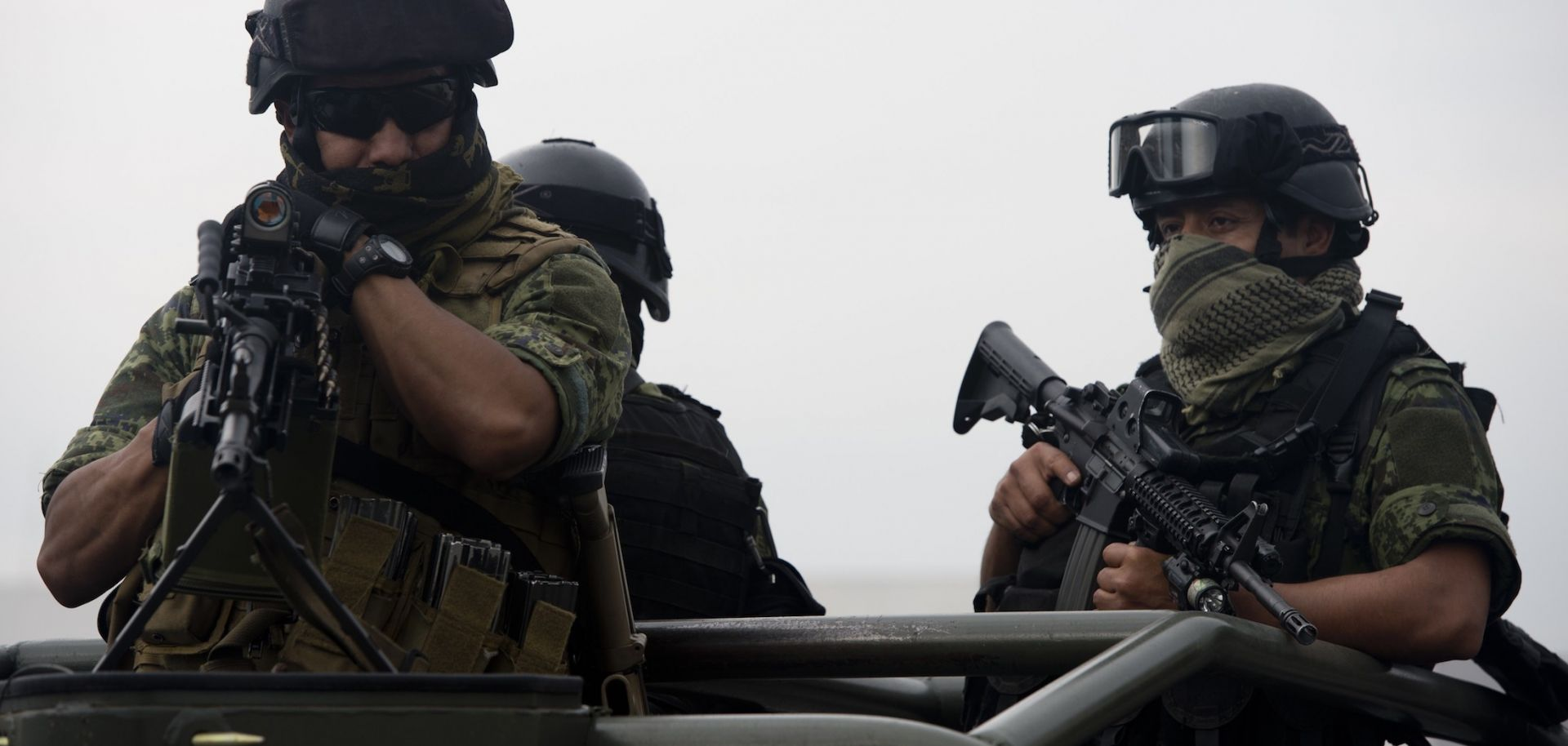 Soldiers stand guard as an alleged leader of the Gulf Cartel is presented to the media May 25, 2014, at the hangar of the Attorney General's office at Benito Juarez International Airport in Mexico City.