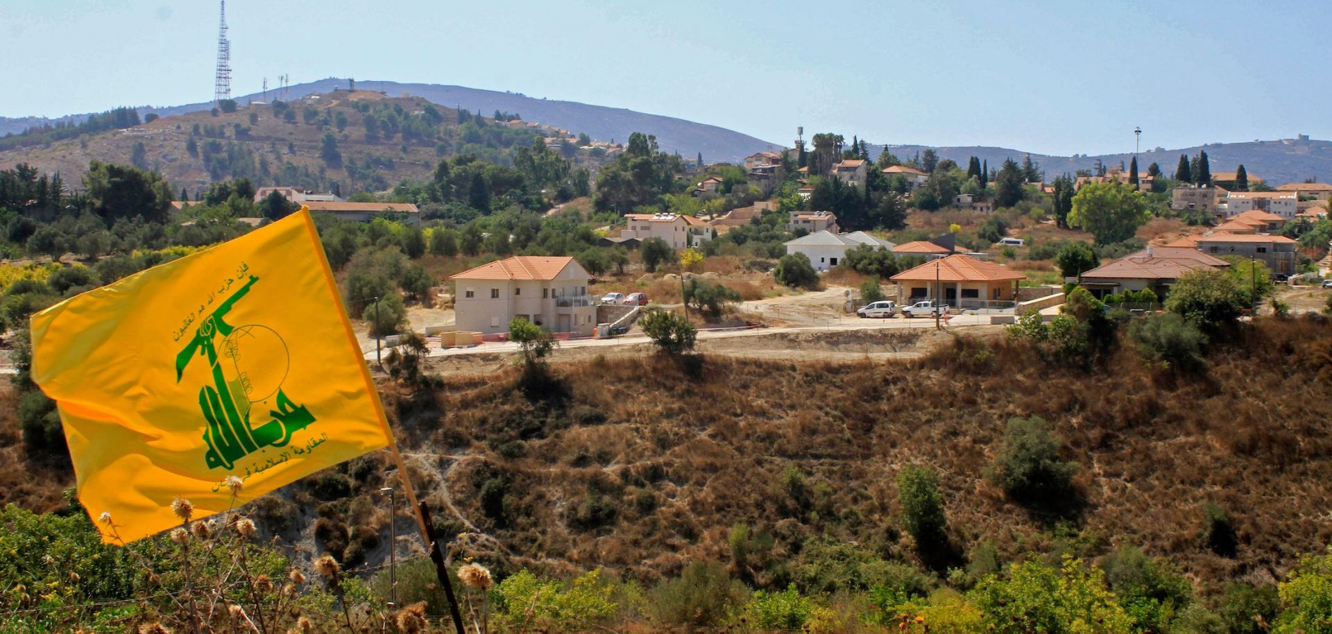 A Hezbollah flag flutters on the Lebanese side of the border with Israel on Sept. 2, 2019.