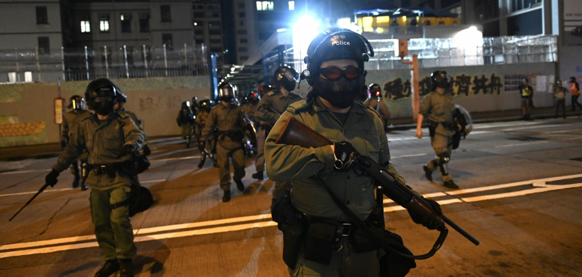This photo shows riot police in Hong Kong standing guard outside a police station on Oct. 7, 2019.