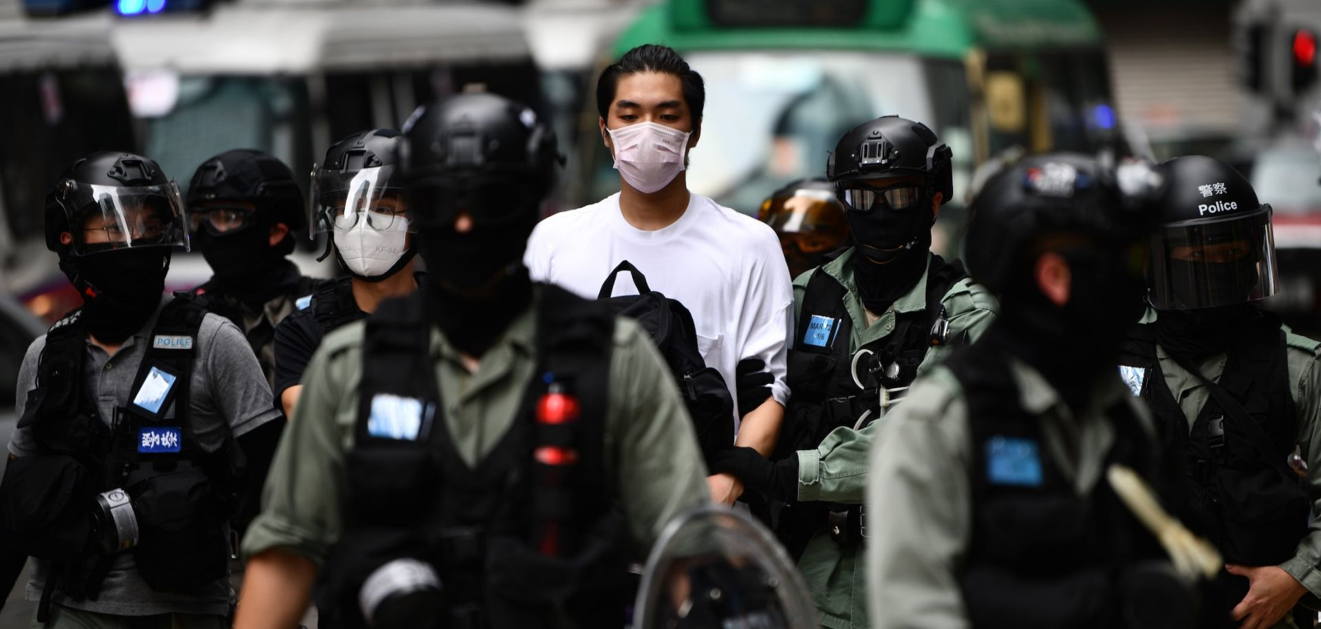 A man is detained by riot police in downtown Hong Kong during a pro-democracy demonstration on May 27, 2020.
