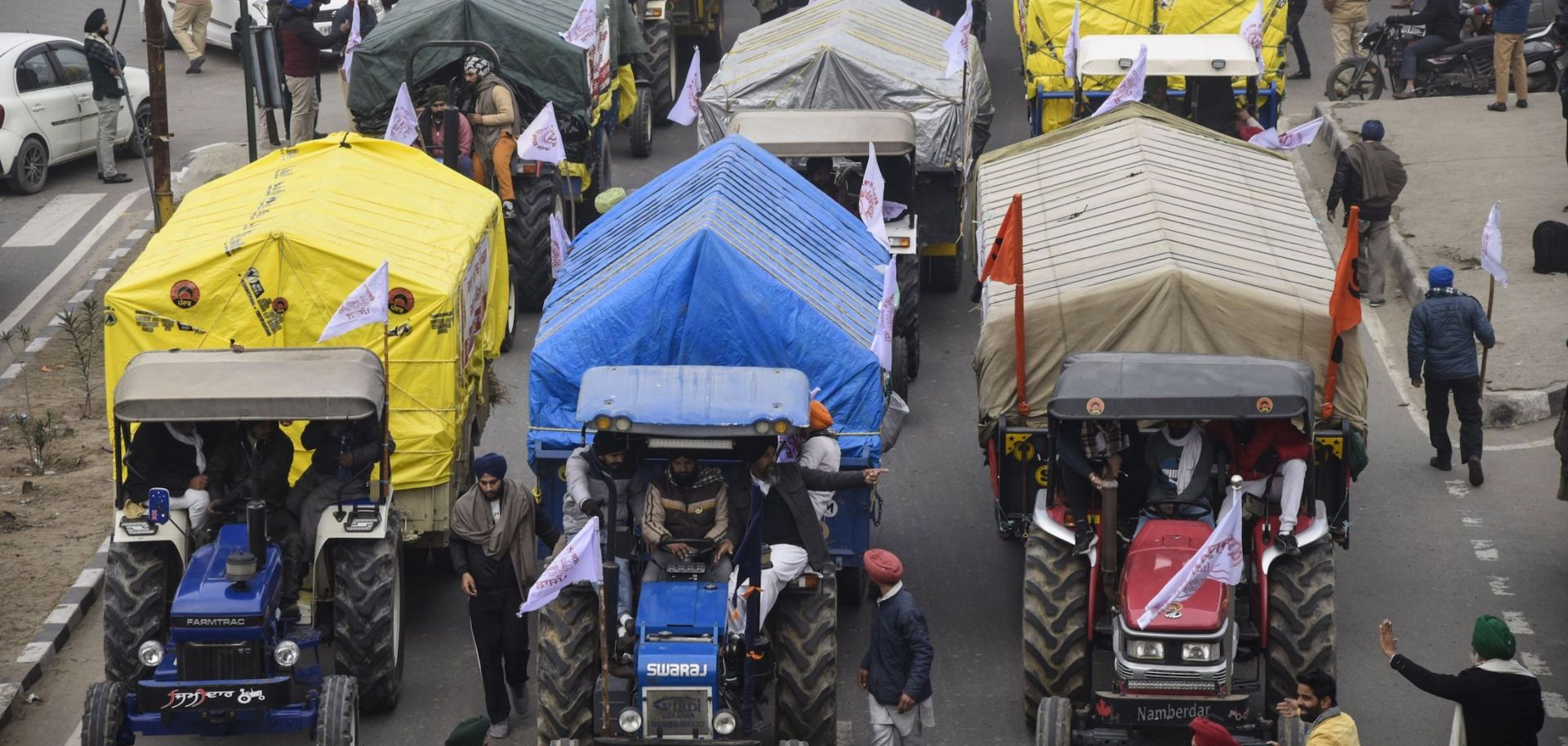 Farmers depart on their tractors to New Delhi to participate in ongoing protests against the Indian government's new agricultural reforms in Amritsar, India, on Jan. 12, 2021.