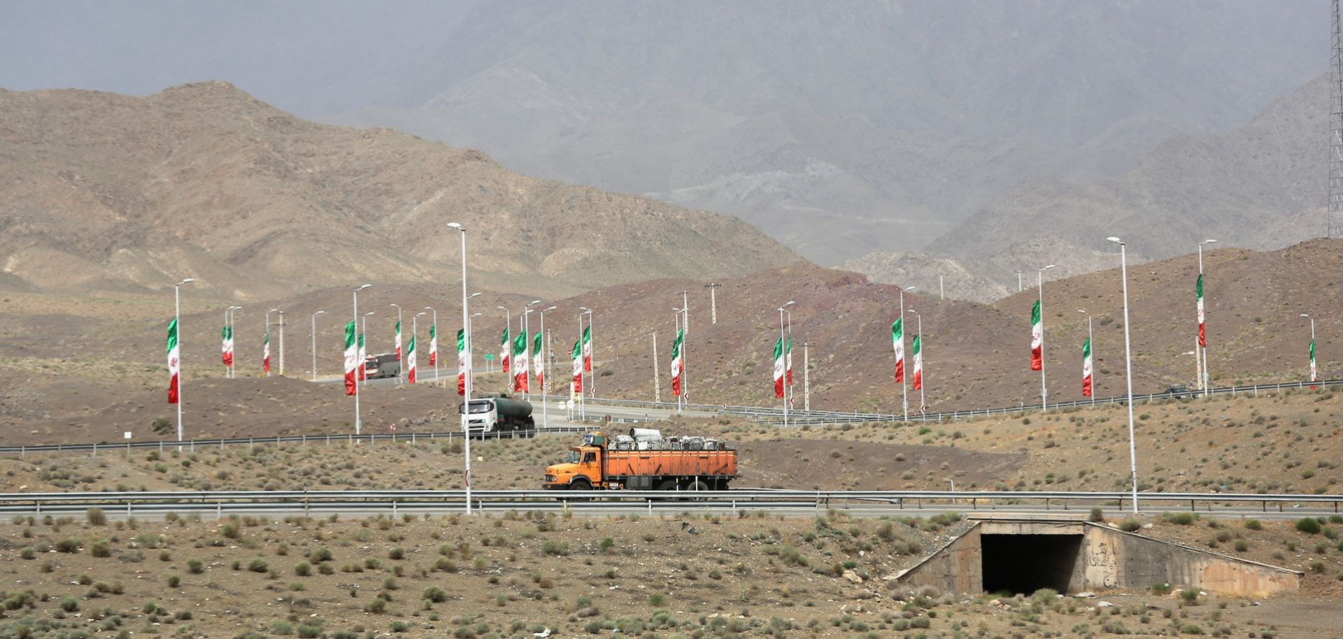 Iranian flags fly along a highway in Natanz in June 2014.