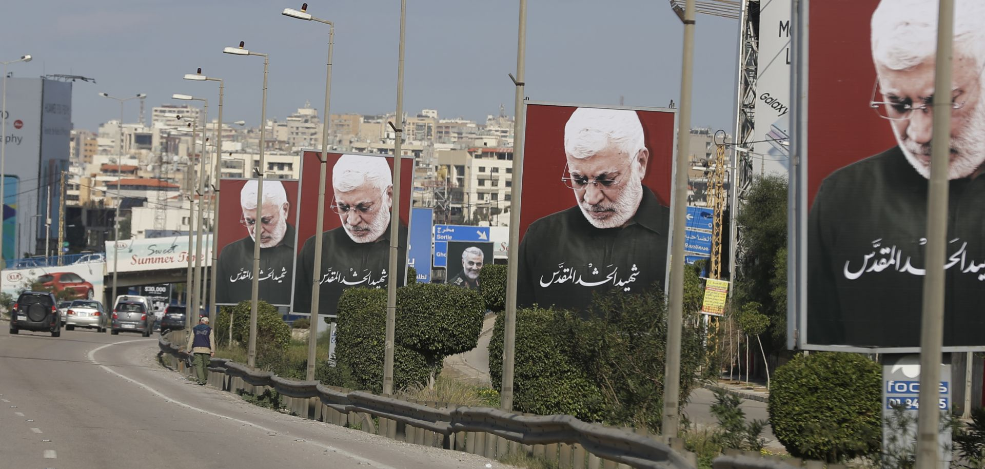 A picture taken on Jan. 11, 2020, shows portraits of Iraq's slain Popular Mobilization Unit deputy chief Abu Mahdi al-Muhandis, the late founder of Kataib Hezbollah, on the southern exit of the Lebanese capital Beirut.
