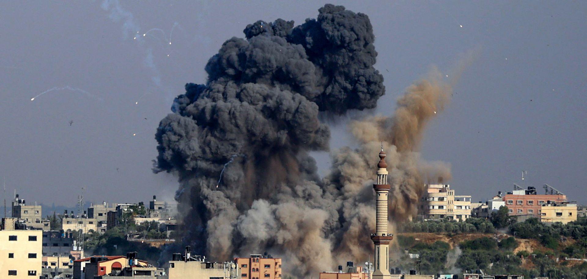 Smoke billows from Israeli airstrikes in Hamas-controlled Gaza City on May 11, 2021.