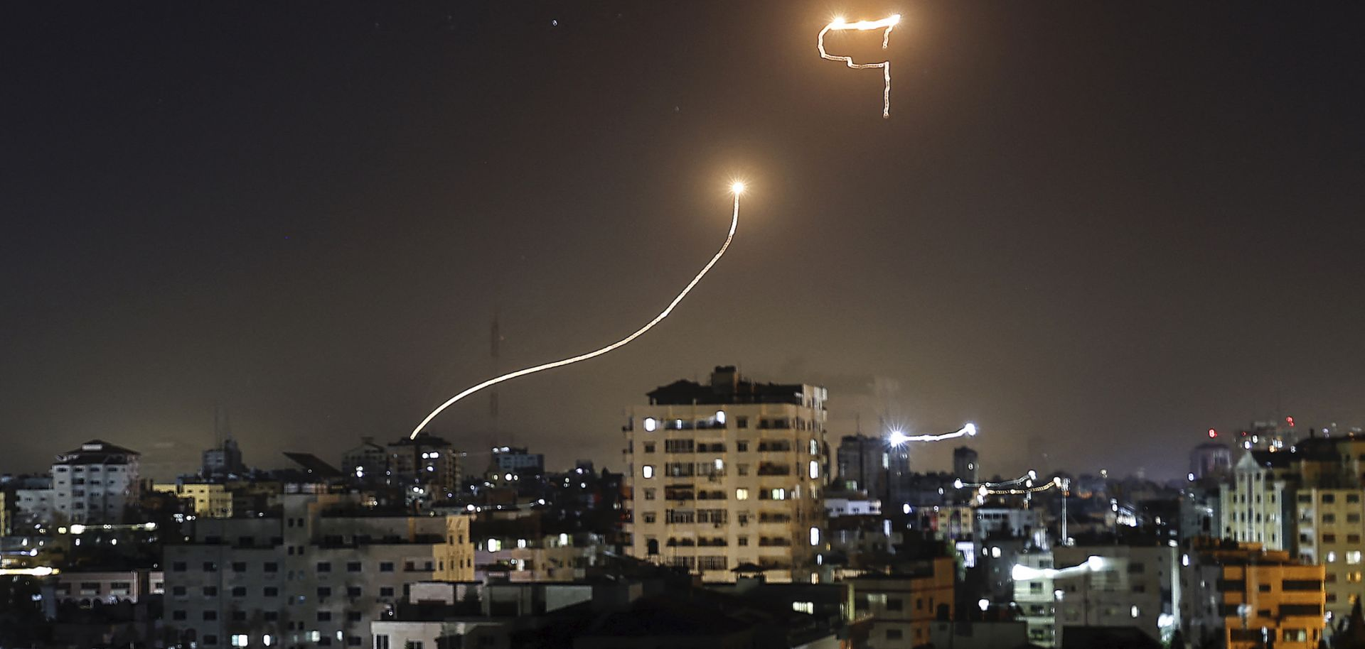 A streak of light appears as Israel's Iron Dome anti-missile system intercepts rockets on May 16, 2021, launched from the Gaza Strip.