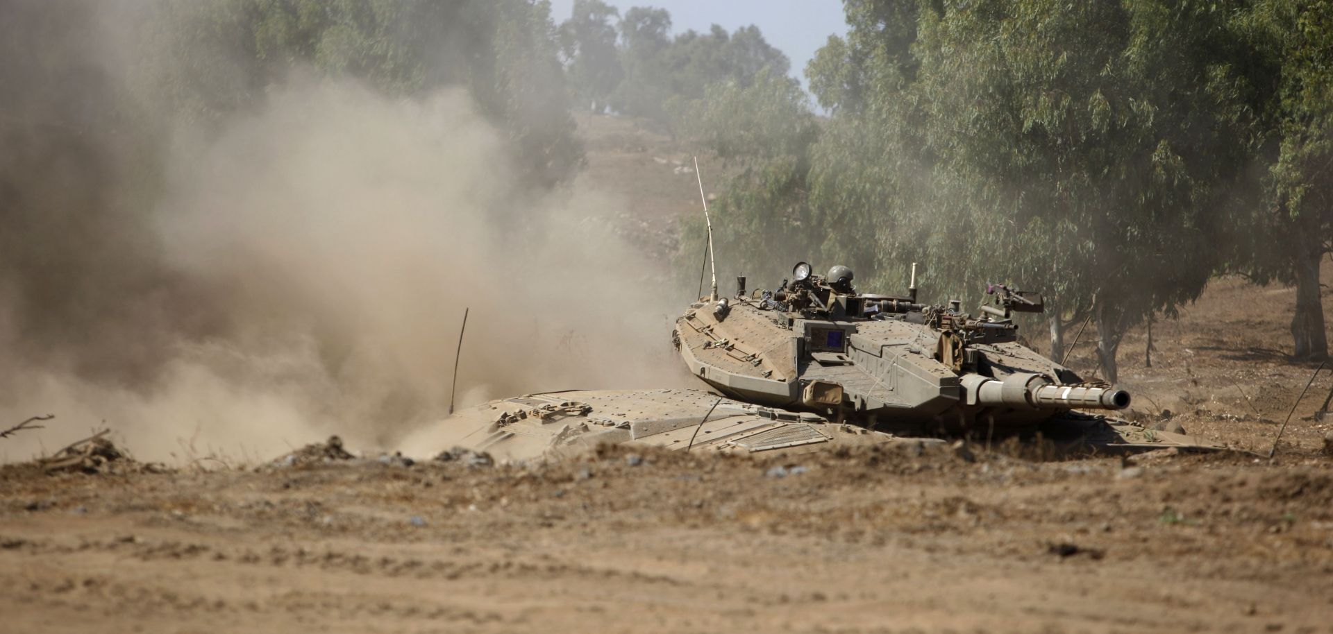 An Israeli army tank maneuvers during Israel's largest military exercise since 1998. The exercise focuses on preparing for a potential war with Hezbollah along Israel's northern border.