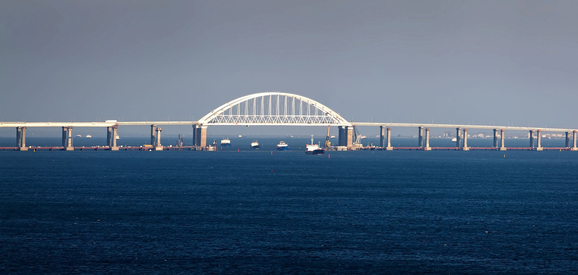 Cargo ships pass under a bridge over the Kerch Strait, which joins the Sea of Azov and the Black Sea.