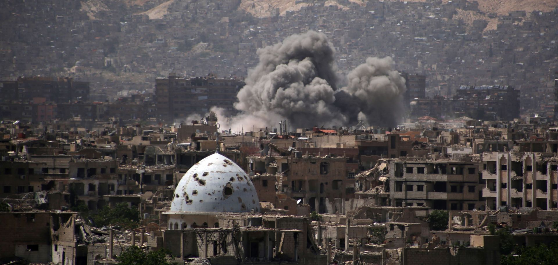 Smoke rises from an airstrike on Jobar, a rebel-held district on the eastern outskirts of Damascus. As Russia is discovering, it will be difficult to disengage from the conflict it has become embroiled in.