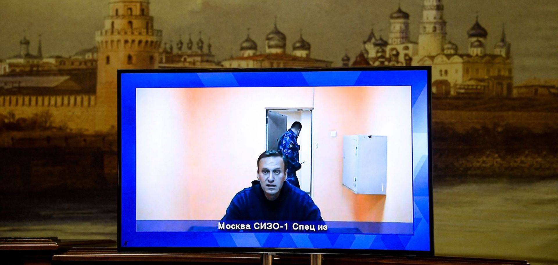 Russian opposition leader Alexei Navalny appears on a screen via a video link from Moscow's penal detention center during a court hearing of an appeal against his arrest in Krasnogorsk, Russia, on Jan. 28, 2021.