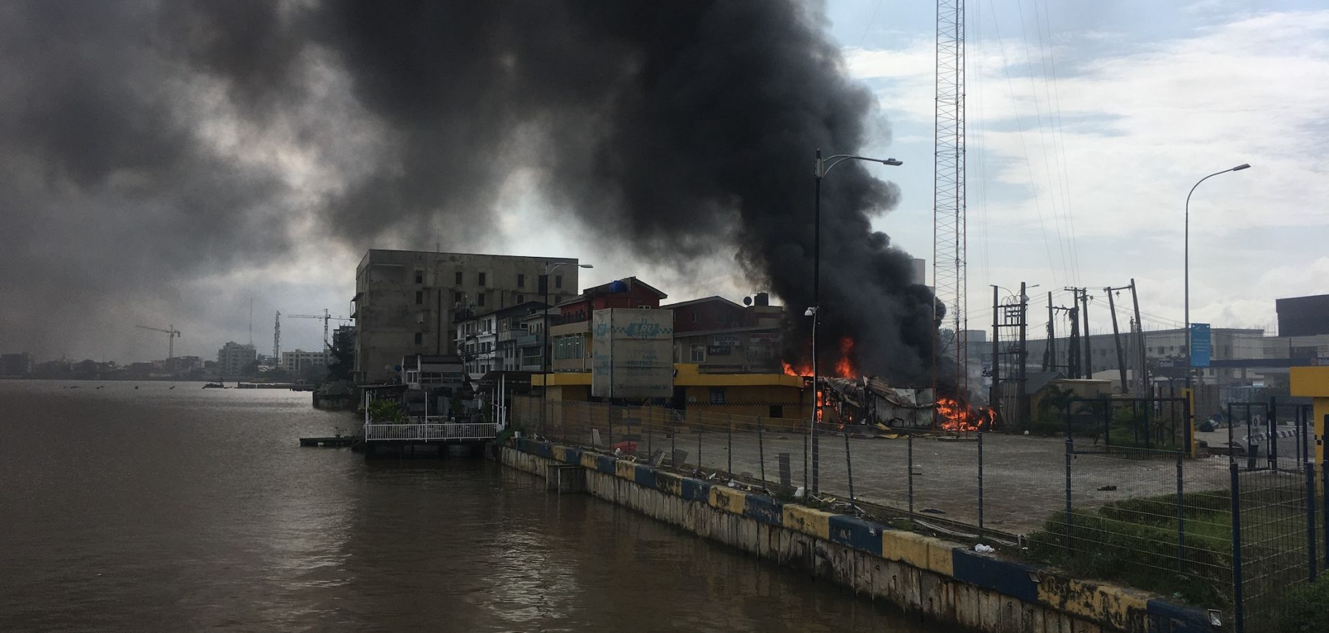 A building remains on fire in Lekki, Nigeria, on Oct. 21, 2020, after #EndSARS protests escalated into violent clashes with police the previous night.
