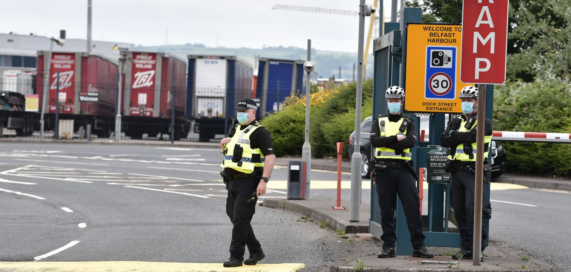 Police officers stand guard as pro-British loyalists protest against the Northern Ireland Protocol at Belfast Harbour on July 3, 2021.