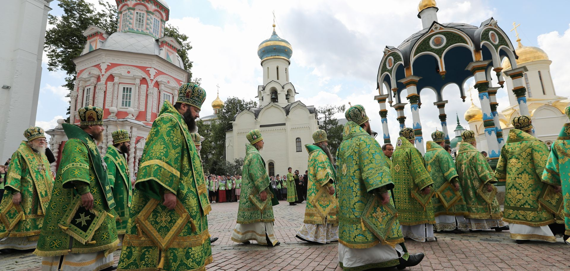 Patriarch Kirill of Moscow and all Russia and priests walk through the streetsof Moscow after a divine liturgy.