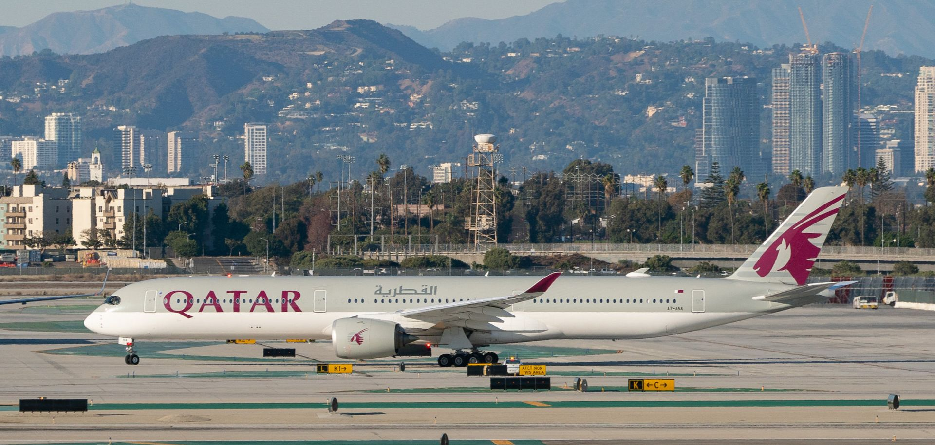 A Qatar Airways passenger jet prepares for take-off on the tarmac of the Los Angeles International Airport on Nov. 11, 2020, in Los Angeles, California.