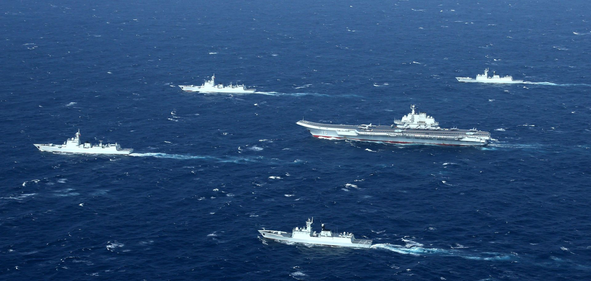 A Chinese navy formation, including the aircraft carrier Liaoning (C), during military drills Jan. 2, 2017, in the South China Sea.