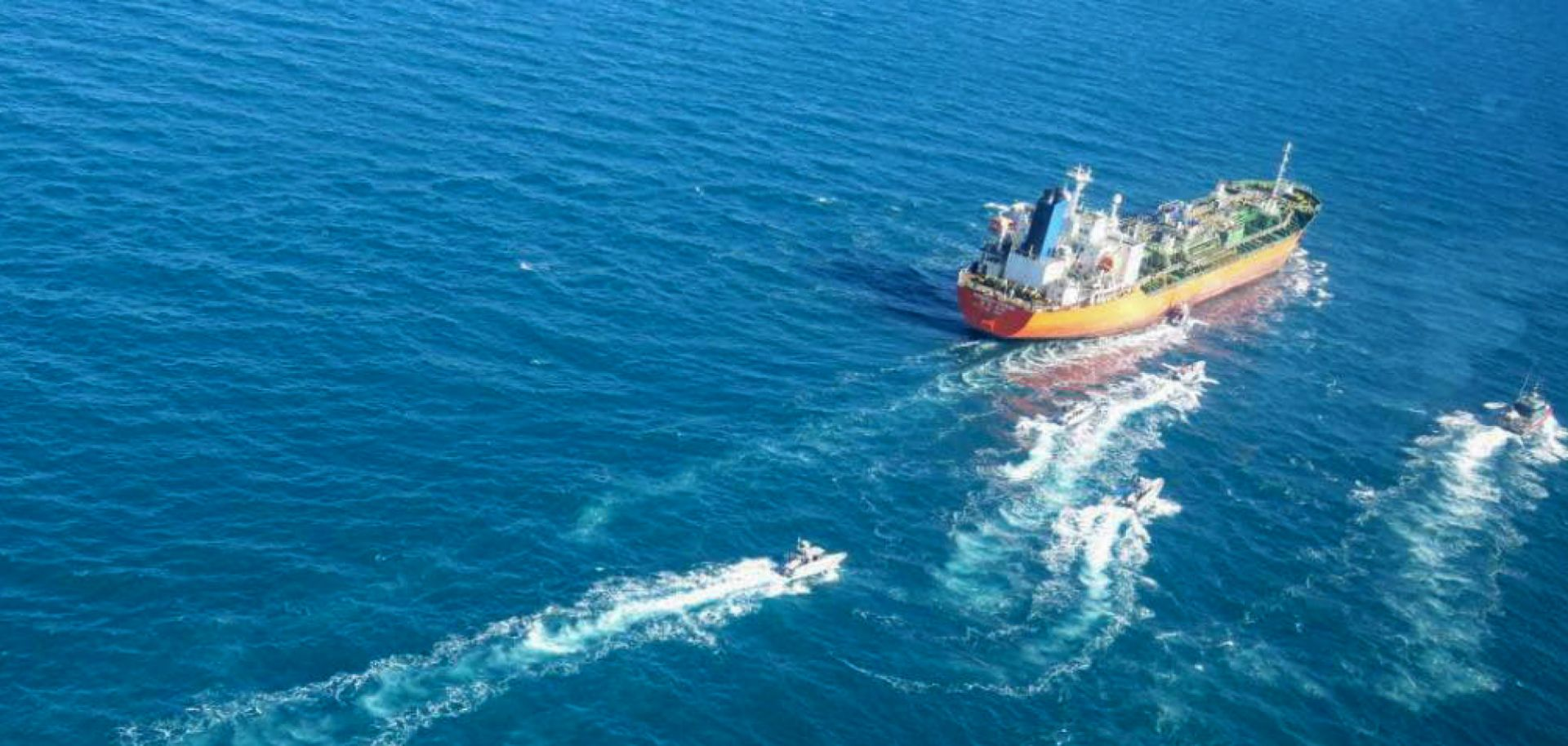 A South Korean-flagged tanker is escorted in the Persian Gulf after being seized by the Iranian navy on Jan. 4, 2021.