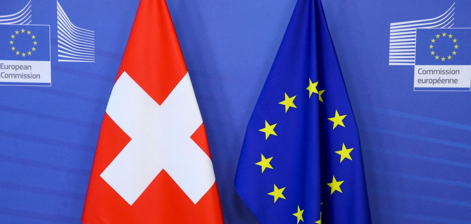 Switzerland's national flag (left) is pictured next to the EU flag at the European Commission building in Brussels, Belgium.