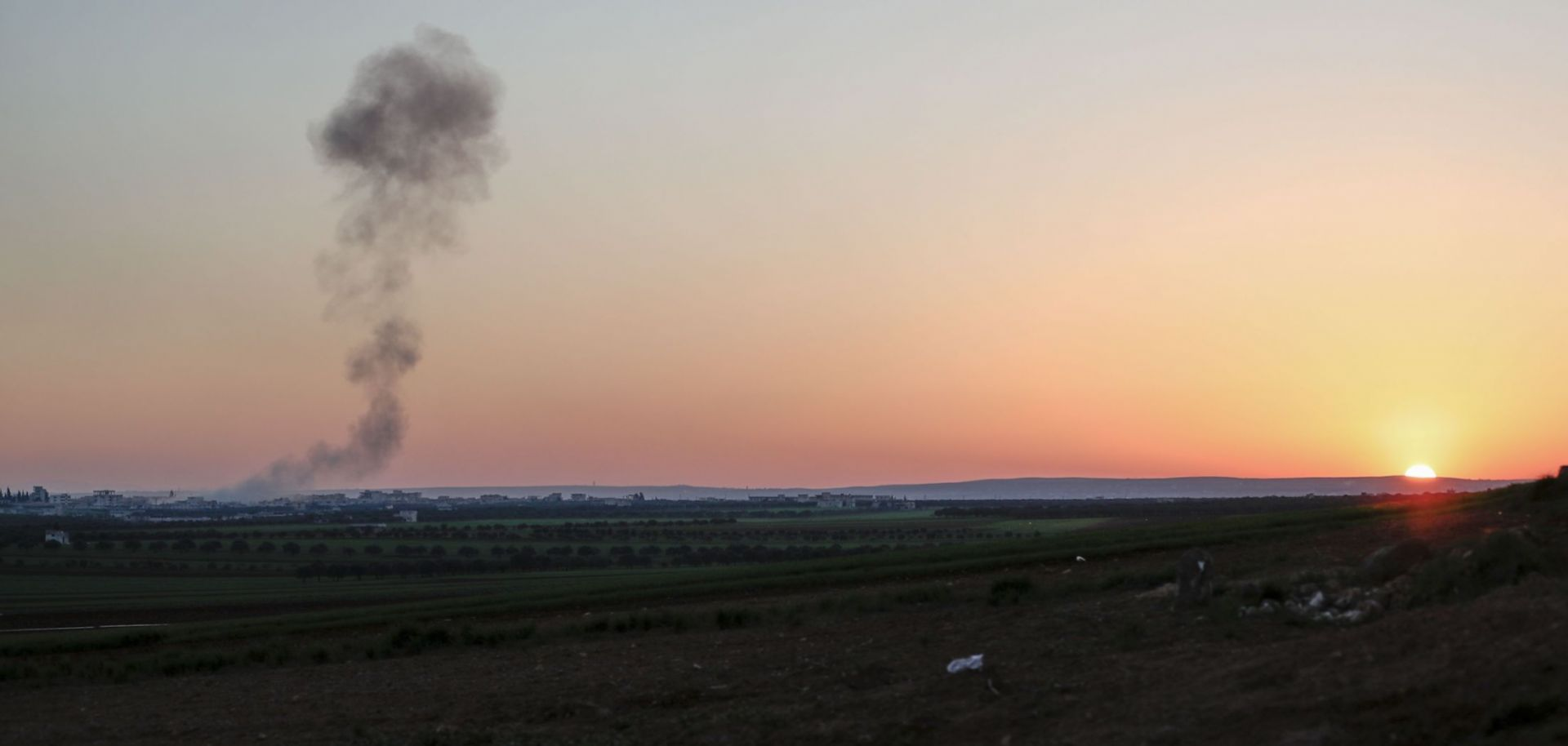Smoke billows above a Syrian village following an airstrike raid on March 3, 2020.