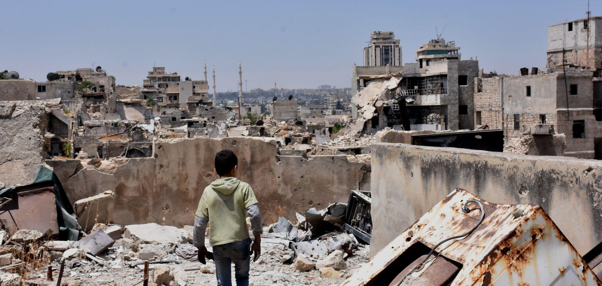 A boy walks amid the rubble in Aleppo, Syria.
