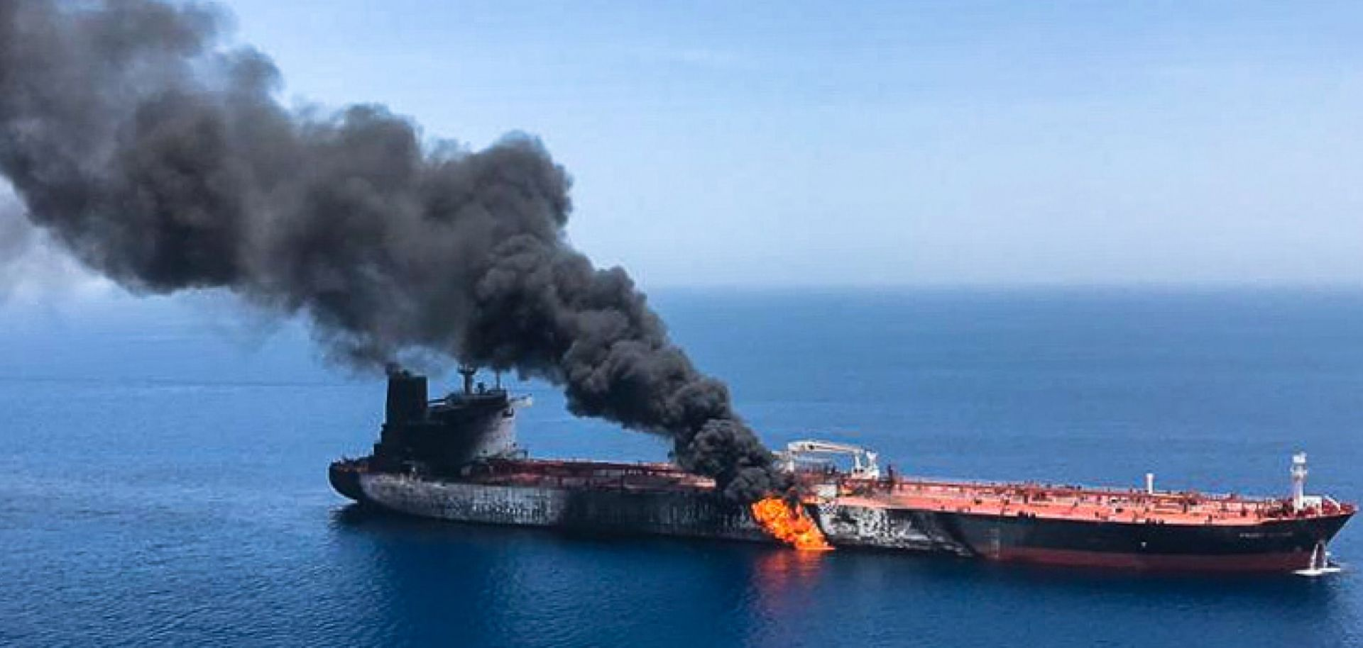 A picture from June 13 shows fire and smoke billowing from the Norwegian-owned Front Altair tanker, said to have been attacked in the waters of the Gulf of Oman.