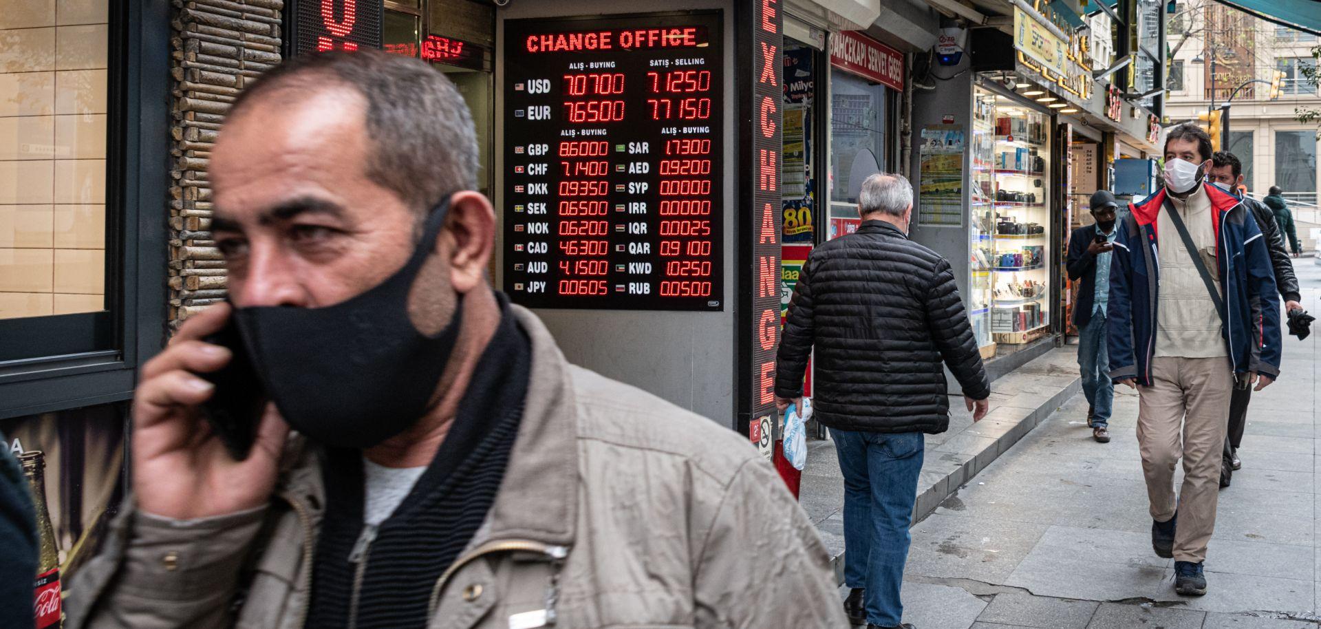 Pedestrians wearing masks walk down a street in Istanbul'sEminonu district on May 5, 2020.