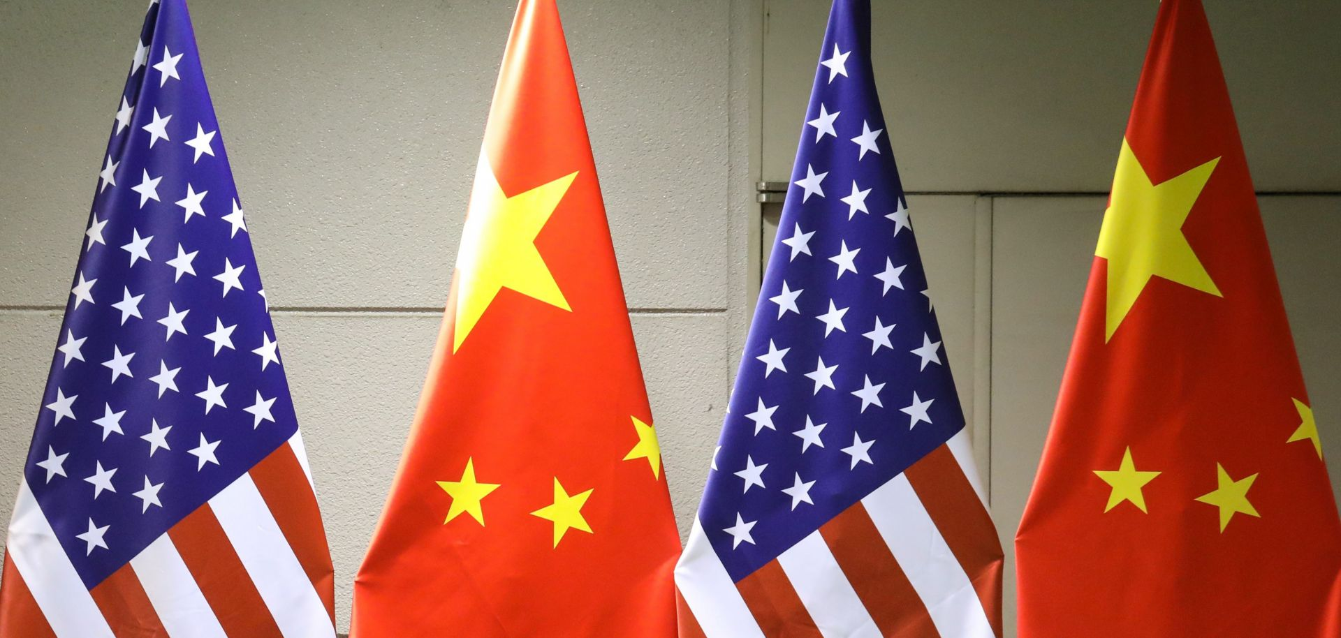 A display shows the national flags of China and the United States at the Group of 20 (G-20) Summit in Osaka, Japan, on June 29, 2019.