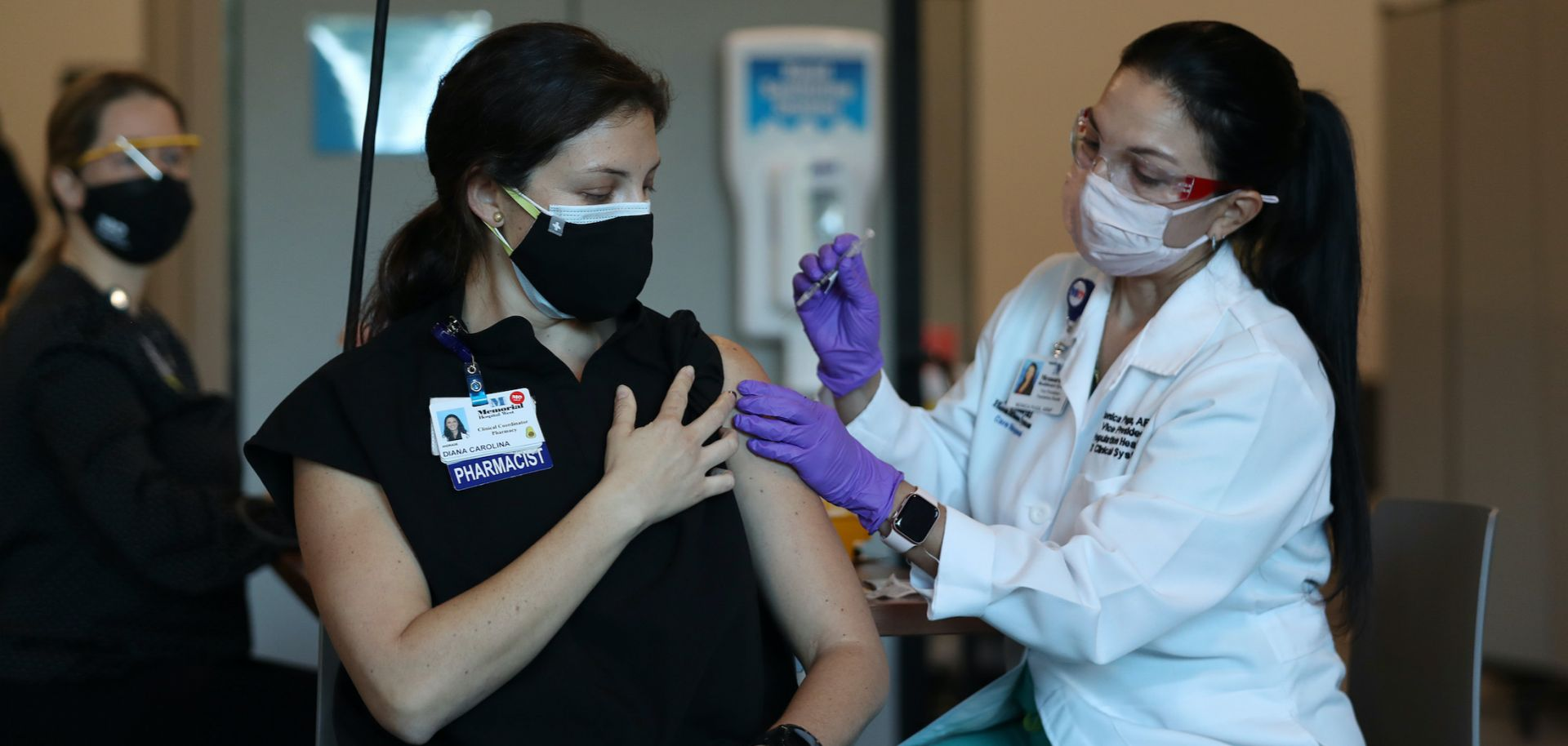 A pharmacist receives her first dose of the Pfizer COVID-19 vaccine in Miramar, Florida, on Dec. 14, 2020.