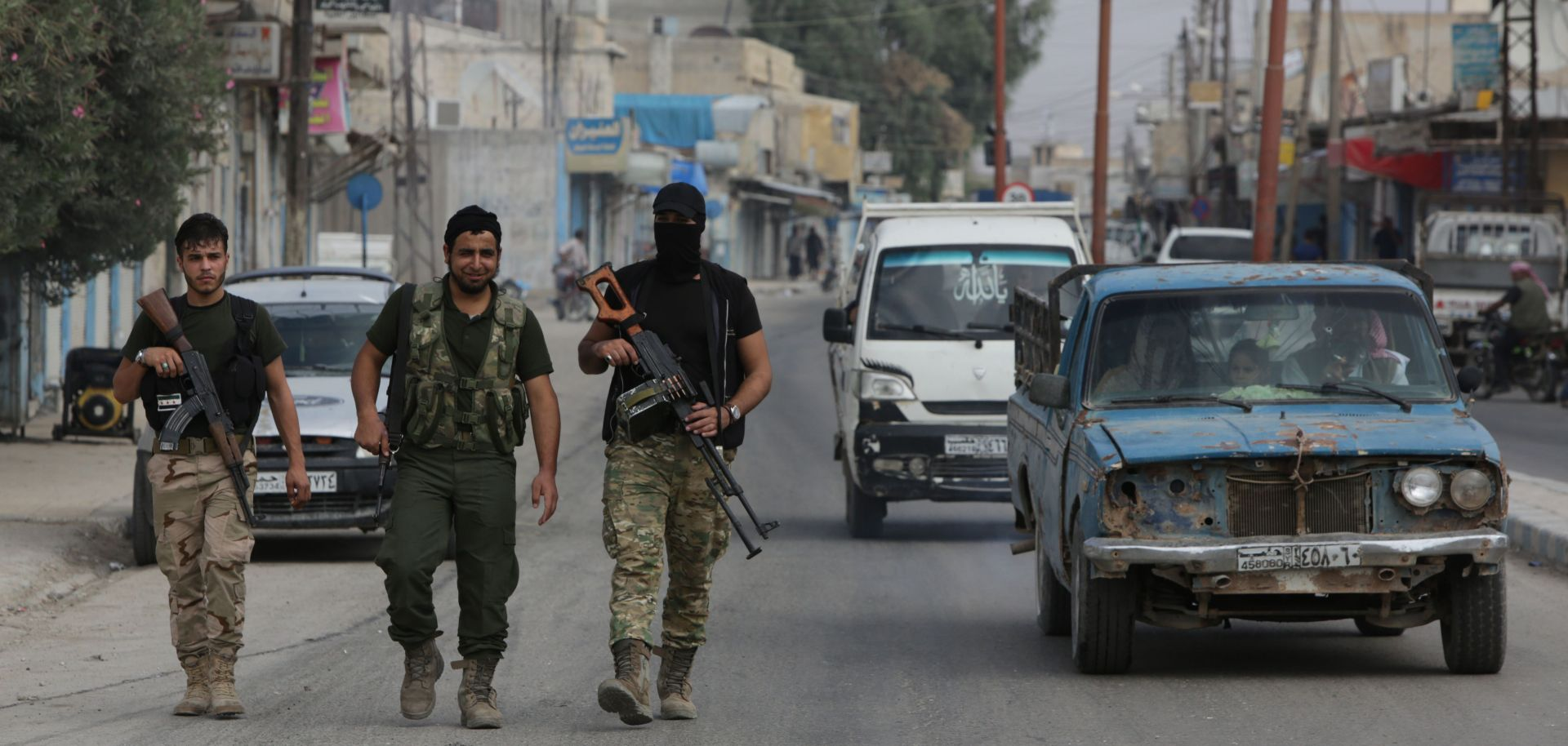 Turkish-backed fighters in the Syrian border town of Tal Abyad