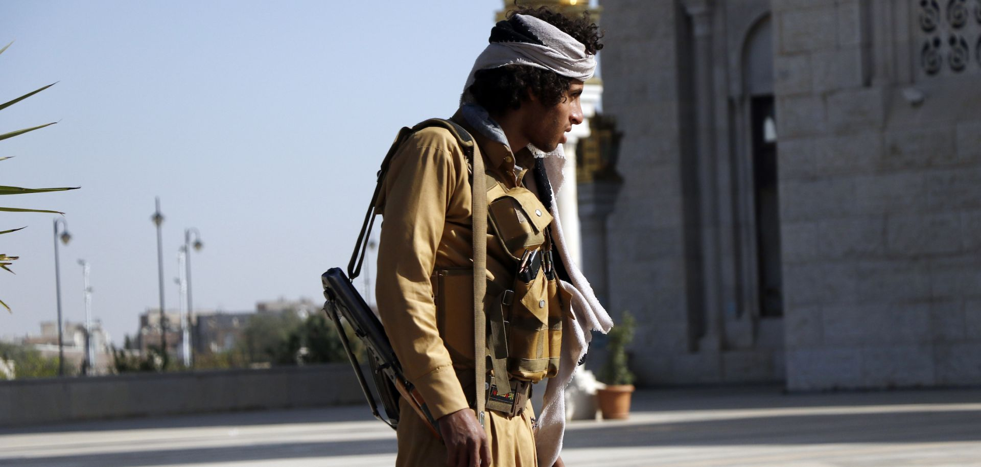 A Houthi fighter stands outside at a funeral for rebels killed in Marib, Yemen, on Feb. 28, 2021.