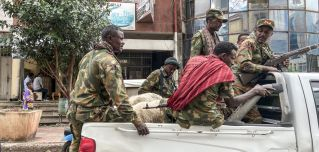 Members of the Amhara militia fighting alongside Ethiopian forces in Tigray ride on the back of a truck in Gondar, Ethiopia, on Nov. 8, 2020.