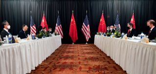 U.S. and Chinese officials face each other during talks in Anchorage, Alaska, on March 18, 2021.