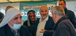 Mansour Abbas, head of Israel's Islamic Ra'am party, speaks with supporters during a rally in the northern Israeli village of Maghar on March 26, 2021.